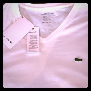 New with tags. Lacoste white v neck. U.S XXL FR 7